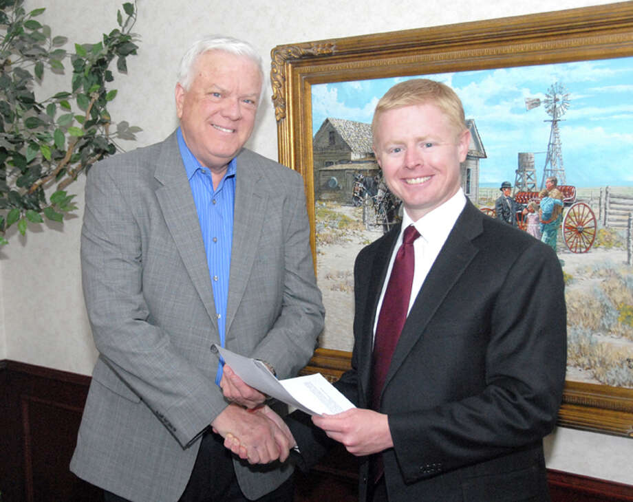 Wayland Baptist University PhotoTyler Topper, a 2005 Wayland graduate, presents Wayland Baptist University President Dr. Paul Armes with a check for $5,000. The check was a donation of the attorney's fees from Burdett, Morgan, Williamson & Boykin, LLP, where Topper works. The law firm negotiated an easement settlement for the university.