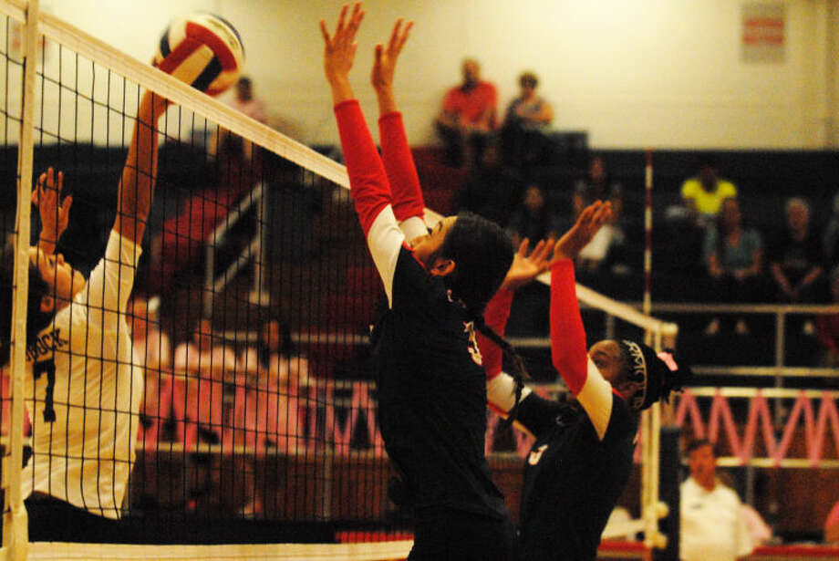 Lupita Quintanilla (right) blocks a Lubbock High shot during a District 4-4A volleyball match at the PHS gym Tuesday night. Plainview held off Lubbock to win in five games. Photo: Skip Leon/Plainview Herald