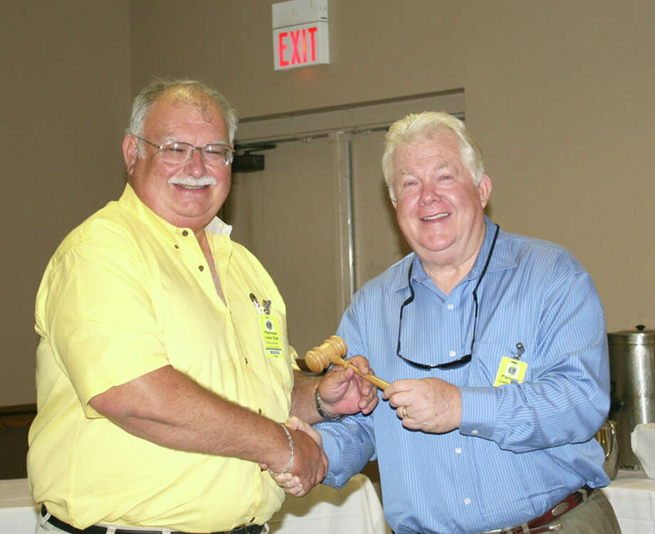 Courtesy PhotoOutgoing Lions Club President Mike Melcher (right) hands over the gavel to incoming President Rusty Ingram at last week's club meeting. Ingram assumes his new post July 1.