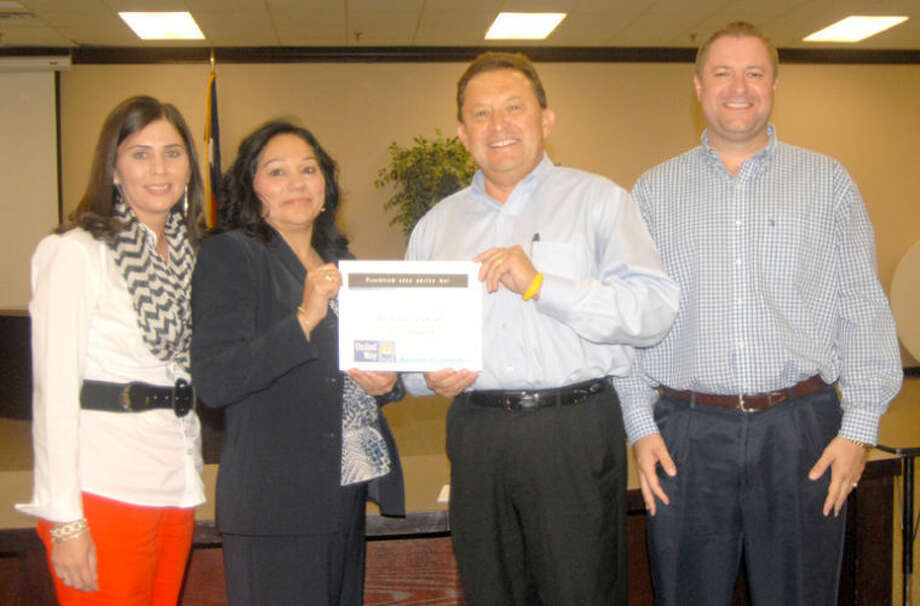 Doug McDonough/Plainview HeraldProsperity Bank was recognized at Thursday's Plainview Area United Way report meeting as being a 100 percent Fair Share Giver, with its entire staff pledging to give at least one hour's pay each month to drive. Campaign chairman V.O. Ortega (second from right) presents a Fair Share certificate to bank representatives Alicia Hernandez (left), Diane Alvarez and Brandon Ahrens.