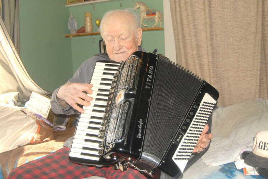 Doug McDonough/Plainview HeraldNinety-year-old Ray Jimenez learned to play the accordion as a child in Weslico and Mission. He still plays the instrument today.