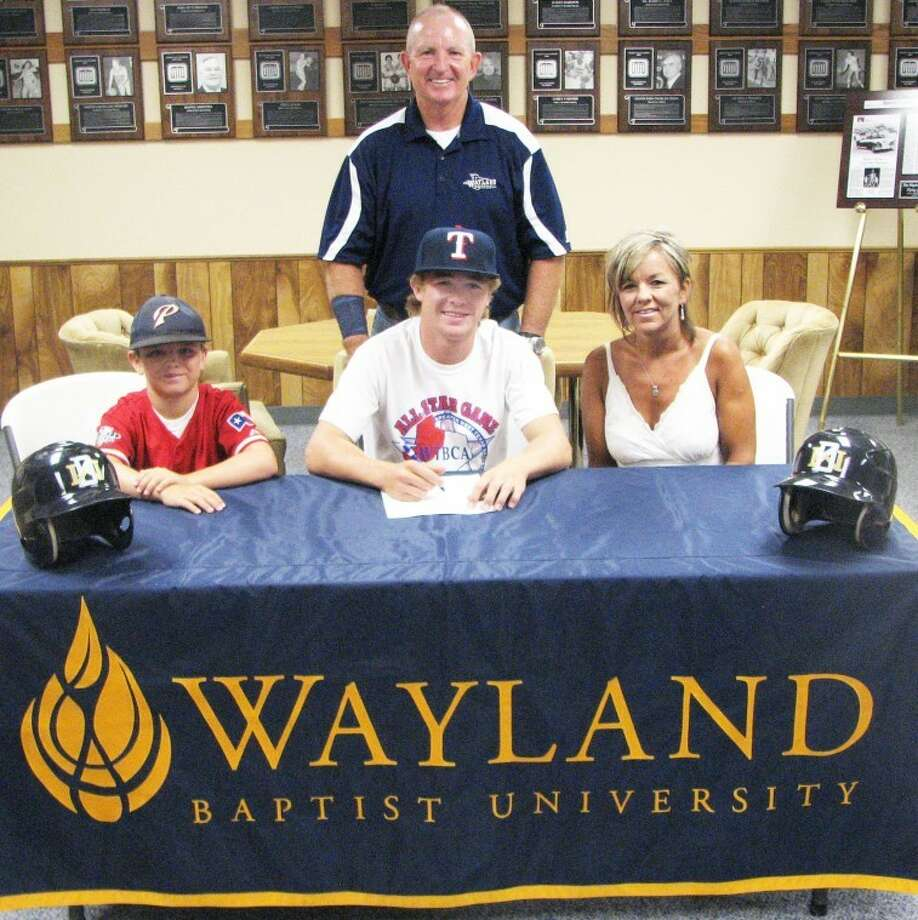 Chance Rollins of Plainview signs an agreement to play baseball at Wayland. With him are his mother, Wistie, and brother, Brant, along with Wayland assistant coach Tommy McMillan. Not pictured is Chance's father, Michael. Photo: Kevin Lewis/Wayland Baptist