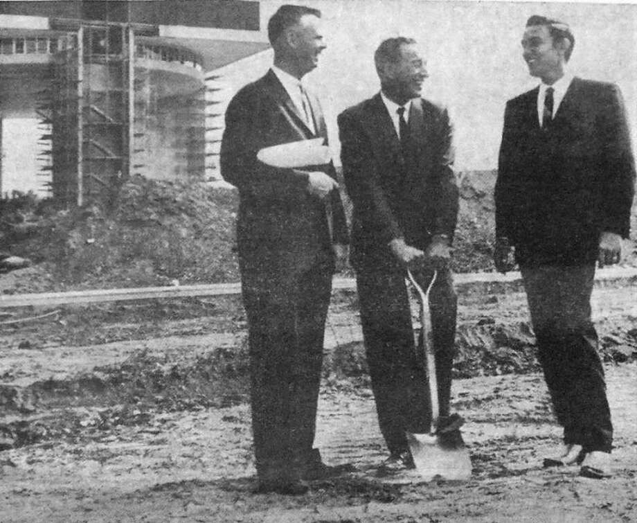 Herald File PhotoA front page Herald photo in October 1963 shows Plainview building contractor Jay Swayze (center) preparing to break ground on an underground house on the future site of the 1964 World's Fair. At left is franchised-builder Walter Nolan, with entertainer Jimmy Dean at right.