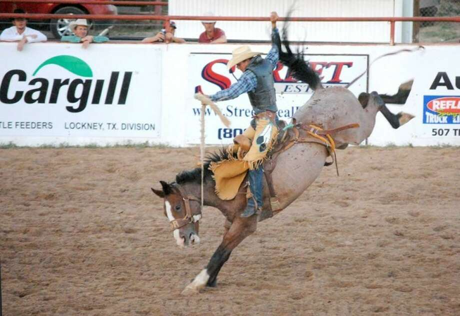 Audy Reed of Spearman was able to stay aboard his saddle bronc Saturday night to post the winning score of 79 to win the event during the 68th annual Bar-None Rodeo. He won $622.94 for his performance, outscoring Will Payne of Beaver, Okla., by a single point. The two-day rodeo wrapped up Saturday night. Photo: Doug McDonough/Plainview Herald