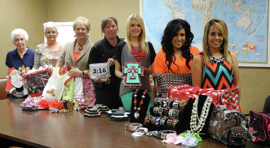 Some of the participants in the 39th Annual Running Water Draw Arts & Crafts Festival are shown with their crafts. Mary Lewis (left), Plainview, clothing accessories, painted decorative items; Barbara Bell, Plainview, decorative bags, checkbook covers, arm corsages and flip-flops; Beverly Hudley, Plainview, bibs, burp rags and blankets; Ellen Burtnett, Hale Center, pens, clocks, lights, key chains and canvas art; Kenzie Wieland, Plainview, hand-cut wooden crosses decorated with acrylic paint; Kimberley and Mary Espinosa, daughter and mother, Hale Center, necklaces, bracelets, belts, bows, purses, bags, big totes. Not pictured are Jo Beth Ware, who shares a booth with Lewis, and Jerrod Burtnett, Ellen's husband and fellow crafter. Photo: Gail M. Williams | Herald Lifestyles Editor