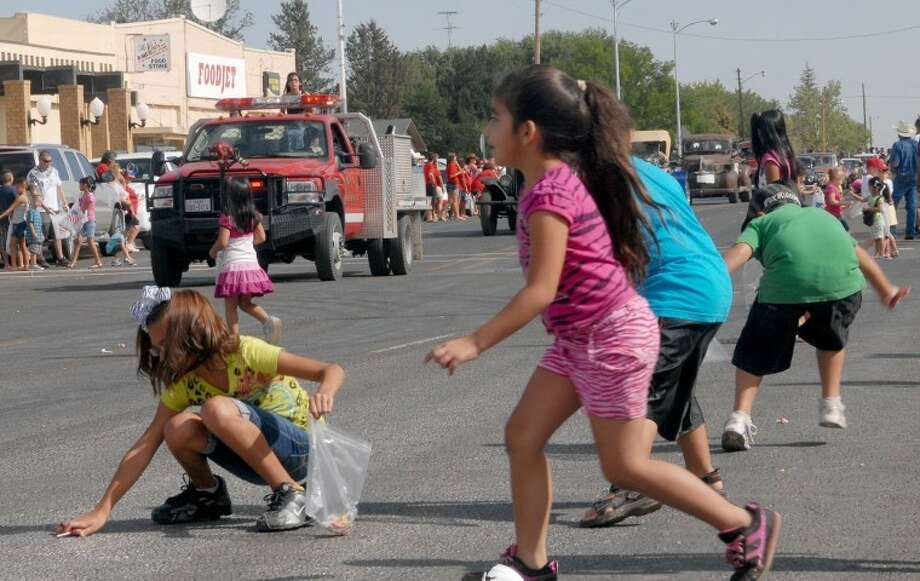 FILE PHOTO: Children scramble for candy during THE Hart Day's parade. Photo: Richard Porter/Plainview Herald