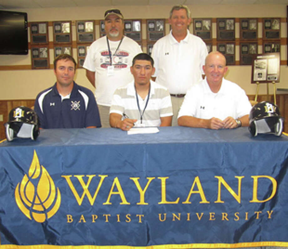 Former Kangaroo Ivan Mariscal signs to join the Wayland Baptist Pioneer Baseball team. Seated, from left) WBU assistant coach Brett Cook, Ivan Mariscal, WBU assistant coach Tommy McMillan; (back) Inosencio Marisca and WBU head coach Brad Bass. Photo: Wayland Baptist University