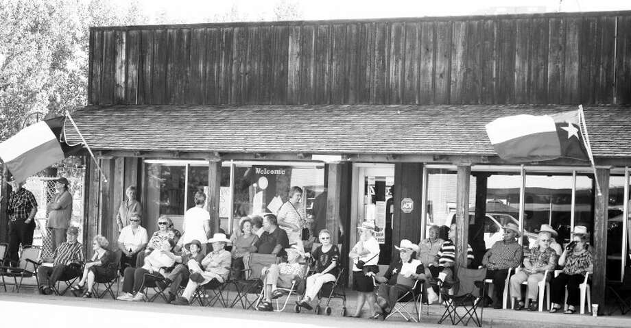A crowd of people awaits the start of the Sandhills Parade last year. This year's events starts Wednesday and runs through Saturday. Photo: Photo Courtesy Of The Olton Enterprise
