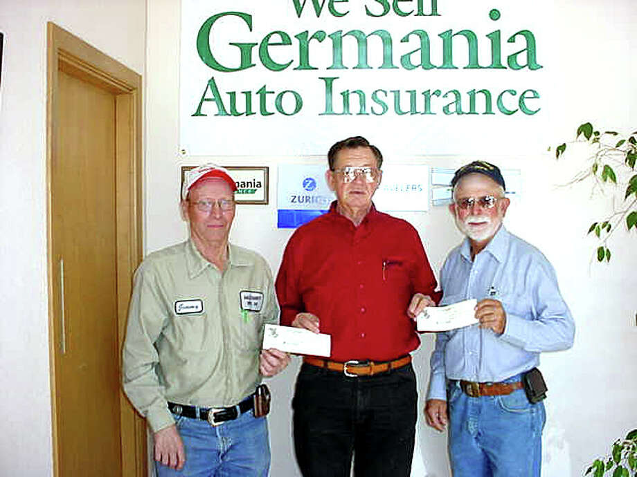 "Dodson Agency Germania Insurance representative Paul Drager (center) presents checks for $250 to Jimmy Goree (left) of the Halfway Volunteer Fire Department and Ron Groves of the Hale Center Volunteer Fire Department. ""Both departments, along with the City of Plainview Fire Department, responded to the fire at the Steve and Krista Marshall home on July 12, and we sincerely appreciate their effort,"" Drager said."