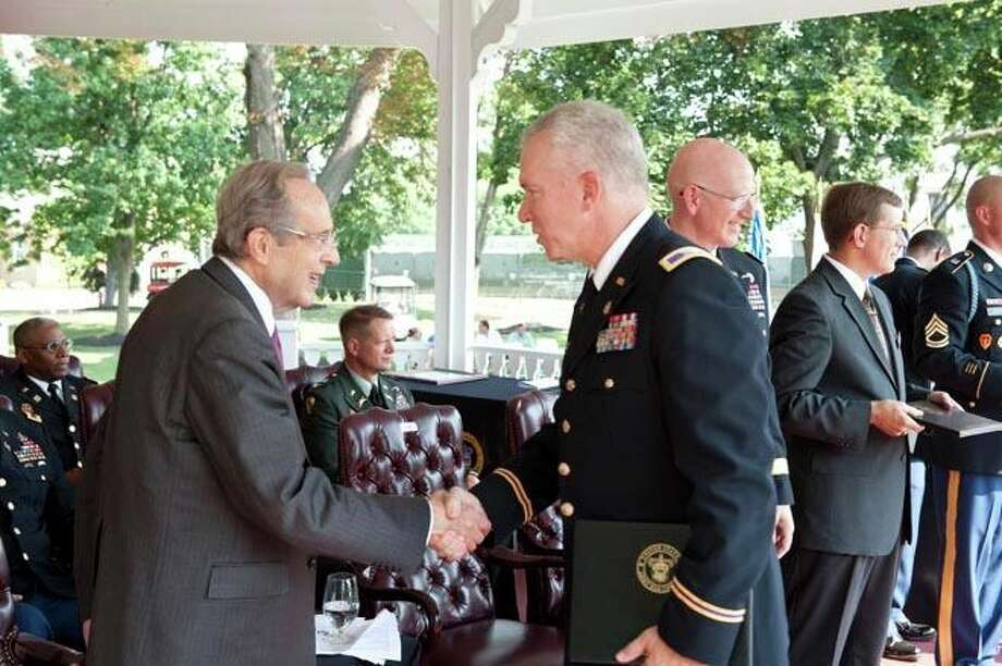 Col. Michael Keller, an Army reservist from Plainview, is congratulated on his recent graduation from U.S. Army War College by former Secretary of Defense Dr. William J. Perry. Photo: Courtesy Photo