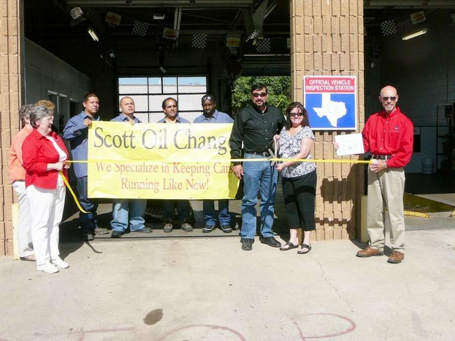 The Plainview Chamber of Commerce hosted a ribbon cutting at Scott Oil Change, 1500 W. Fifth, on Wednesday, which happens to be Ladies Day offering $5 off an oil change. Scott's will pick up your car and deliver it, and they also perform state inspections. Pictured are (from left): Janice Payne with the Chamber, David Lee Gutierrez, Robert Ceniceros, Raul Lopez, Daffrean Jenkins, owners Jorge and Imelda Gonzales, and Chamber President Kenneth Hooper holding the business's ceremonial first dollar.