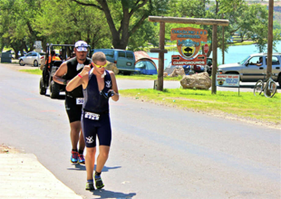 Triathlon runner and former Plainview graduate Carlos Cerda keeps his stride as he completes in the final 13.2 mile running portion of last Sunday's Buffalo Springs Lake Iron Man triathlon. Completion of the grueling race marked an significant milestone for Cerda who had set a goal to finish the course when he was still in high school. Photo: Courtesy Photo