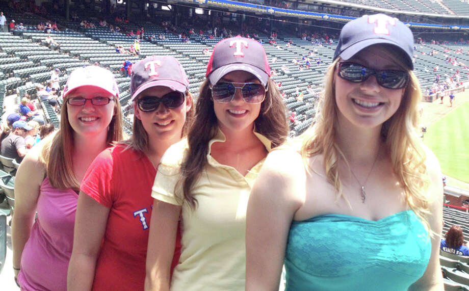 Suzi (left), columnist Jessica Thornton, Gracie and Stephany anxiously await the start of the Rangers game against the Rockies on Saturday. Photo: Jessica Thornton/Plainview Herald