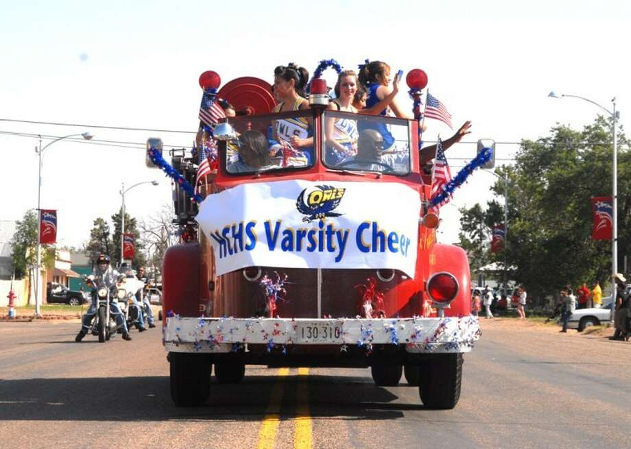 The Hale Center varsity pep squad got to ride in a fire truck in Hale Center's parade. Photo: Doug McDonough | The Herald
