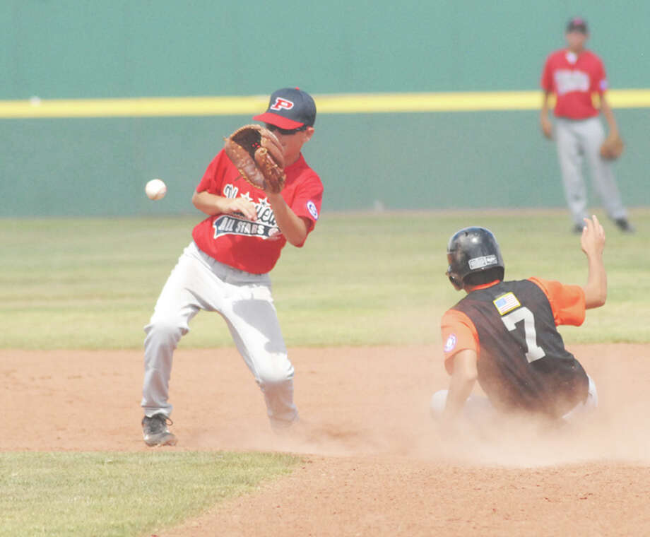 Plainview second baseman Landon Cochran fields a throw as Dumas' Urbano Corral pulls off a steal in Sunday afternoon's Southwest Regional elimination game at Wilder Field. Plainview lost 10-4.