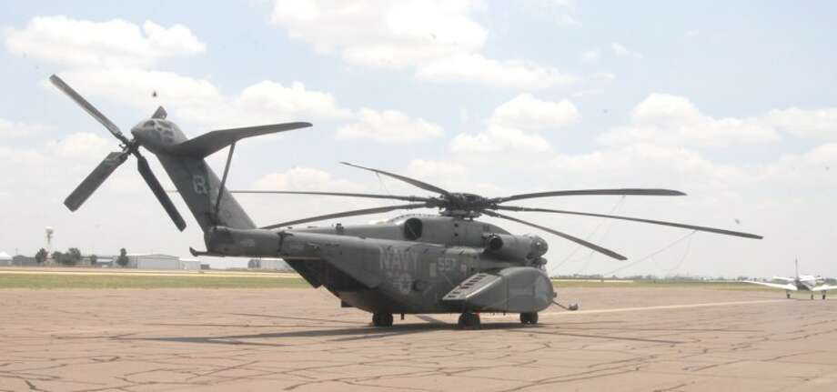 A Sikorsky MH-53E Sea Dragon, reportedly the largest helicopter in the Navy's fleet, stopped off at Plainview/Hale County Airport late Sunday. According to Gary McCormick of Rocket Aviation, the craft was one of two traveling together from Oklahoma to California for military exercises. This particular craft set down near Quitaque due to a warning light indicating a possible problem in the main rotor gearbox. After an initial assessment it was flown on to Plainview, the nearest airport, where it is awaiting repairs. The second helicopter continued to Lubbock, but returned Monday afternoon to pick up personnel and equipment before continuing its journey. According to McCormick, the Sea Dragon has a capacity of 55 combat-ready troops or 24 stretcher patients. It has an overall length of 99 feet, 55 inches. Its maximum speed is 196 mph with a cruising speed of 173 mph. Its range is 540 miles. Photo: Doug McDonough/Plainview Herald