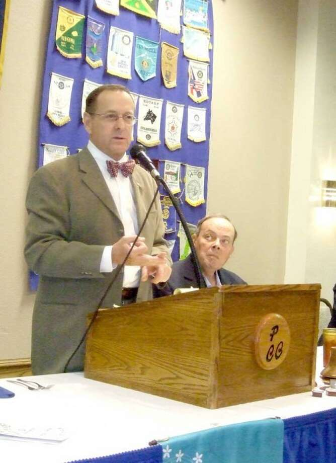 Dr. Michael Graves, a speaker at Tuesday's Rotary meeting, recalls his recent trip to Bangkok, Thailand, for the Rotary International Convention. Graves serves as district governor. Photo: Shanna Sissom | The Herald