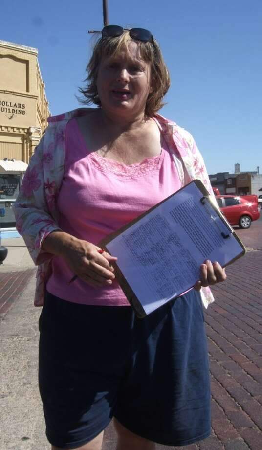 Plainview residents Gayla Carpenter and her daughter, Lesley, were at the corner of Fifth and Broadway this morning seeking signatures on a petition to preserve the sanctity of marriage as the union of one man and one woman. Carpenter plans to forward the signatures to President Barack Obama and U.S. senators and representatives. She hopes to collect at least 5,000 signatures during the next 12 months. Photo: Jessica Thornton/Plainview Herald