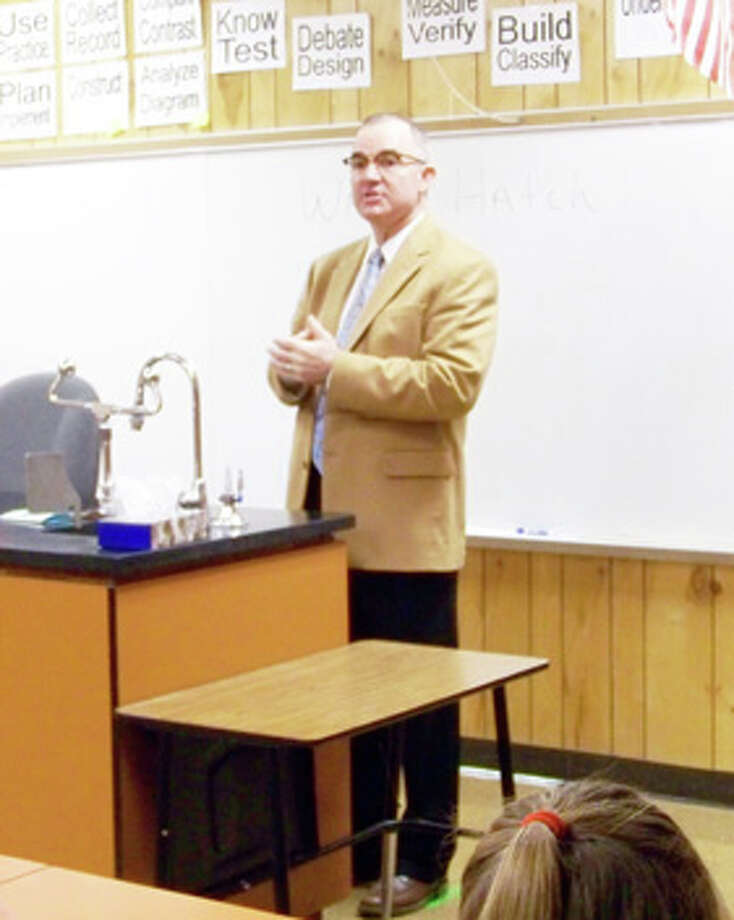 Hale County District Attorney Wally Hatch speaks to students during Coronado Junior High's Career Day.