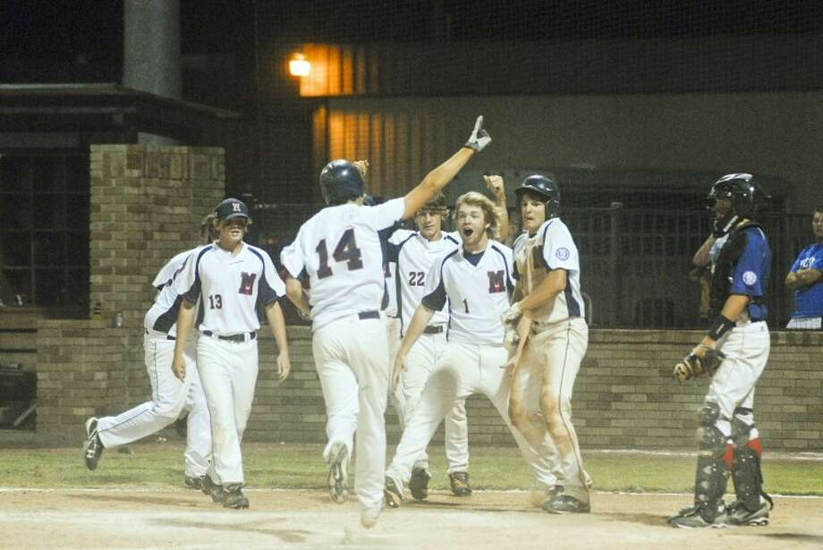 Kevin Lewis/Plainview HeraldAs Patrick Roberts (13), Camp Newcomb (22), Philip Strawn (1) and Brock Roberts prepare to celebrate, Austin Smith (14) raises his finger as he scores the winning run after a two-out, two RBI hit by Dusty Brock in the bottom of the seventh inning gave McComb, Miss., a dramatic 12-11 win over Madisonville, La., on Tuesday night at the 15-year-old Southwest Regional Baseball Tournament at Wilder Field. Also pictured is Madisonville catcher Zach Clark. The teams met again this morning with a trip to the World Series in Jamestown, N.Y., on the line.