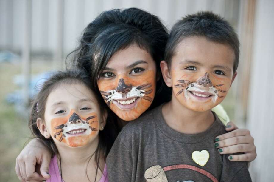 Natalie Gonzales (left) and Tyler Jungman show off their painted faces with Abby Carrasco at Trinity Fellowship's Camp K!djam Vacation Bible School, which was held Monday through Thursday for ages 4 through fifth grade. (For video of the Bible school go to MyPlainview.com.)   Photo: Ryan Thurman/Plainview Herald