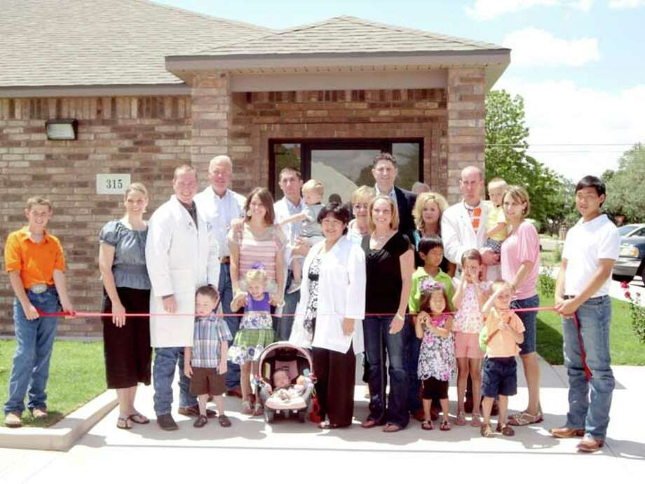 Hale Center celebrated the ribbon cutting Friday of West Texas Family Clinic. The new clinic, located on Cleveland Street, will open July 16 and a formal grand opening will be held later. Among those participating in the ribbon cutting ceremony were Jon Watkins, M.D., Mark McClanahan, D.O., John McClanahan, D.O., Sylvia Bautista, FNP, Christina Flanagan, FNP, KrisAnn Schulz, PA-C, Craig Horton, M.D., and Travis King, M.D.