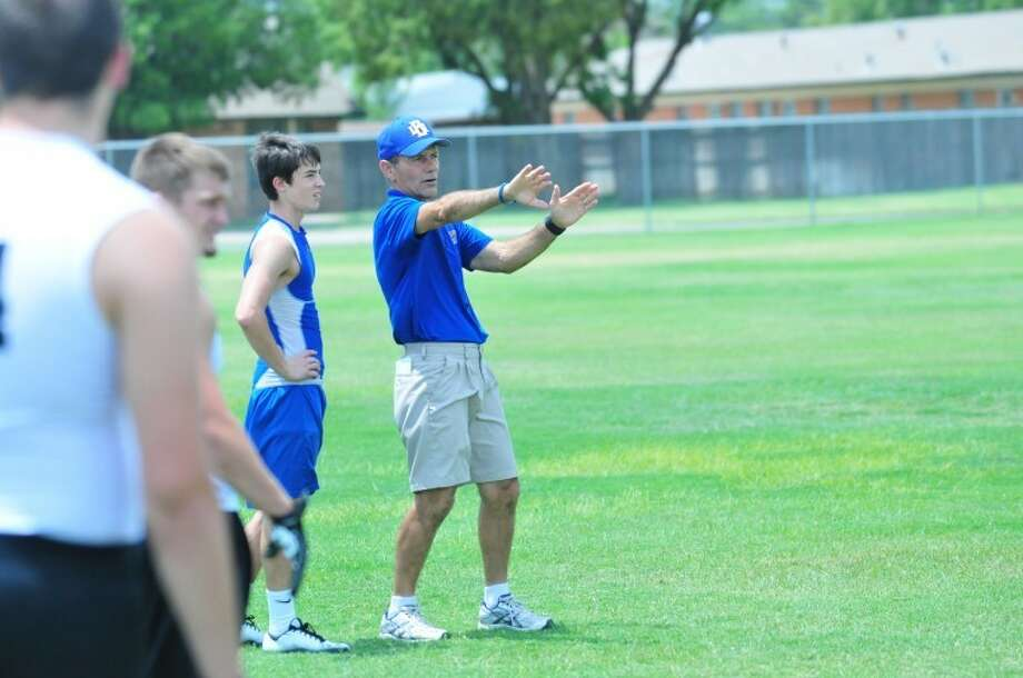 Wayland Baptist University head football coach Butch Henderson (right) teaches how to read defensive coverage during the university's first summer camp. Photo: Homer Marquez/Plainview Herald