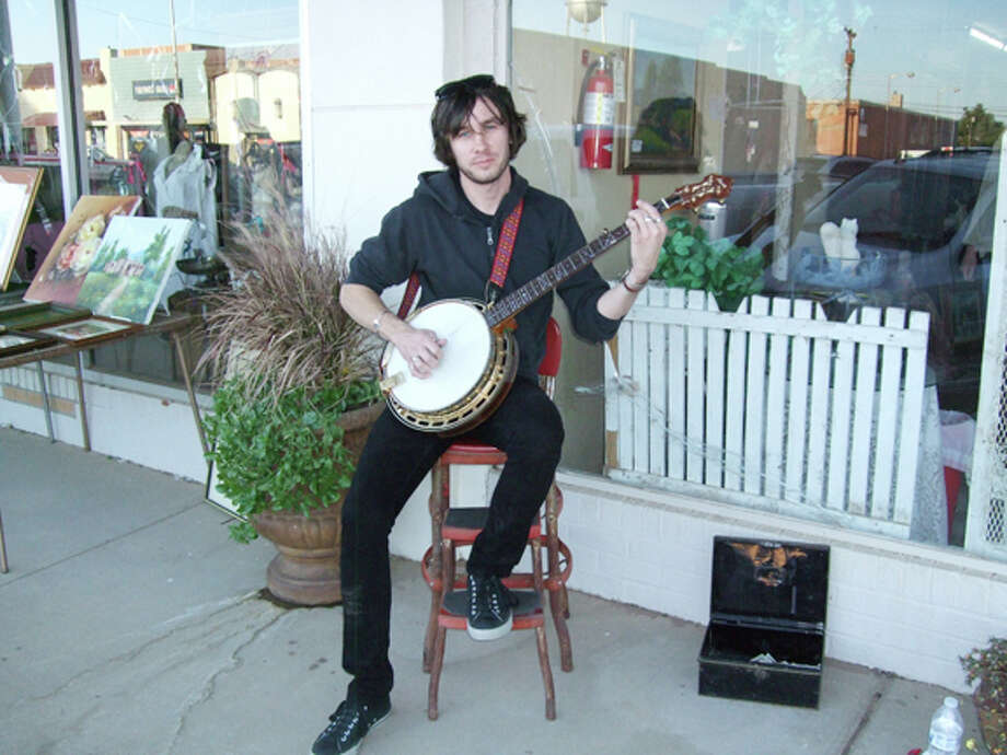 Shane Harmon, a banjo picker from Olton, participated in the first Artwalk Plainview. Photo: Gail M. Williams | Plainview Herald