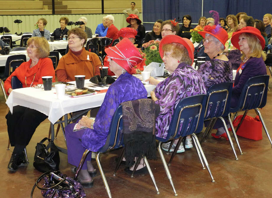 Front and center at the Hi Neighbor Brunch were women from neighboring communities of Olton and Floydada, many of whom were decked out in purple dresses and red hats. Photo: Gail M. Williams | Plainview Herald