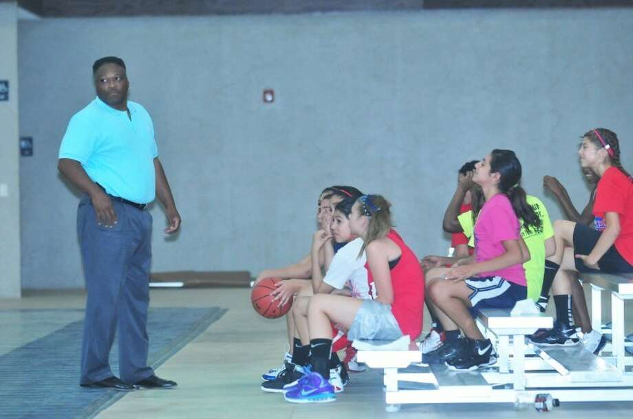 West Texas FUZE Co-founder Richard Miller ready the troops at a recent practice at the Happy Union Baptist Church gym. June 26-29 the FUZE basketball organization will take several teams to compete in the National competition in Dallas. Photo:  Homer Marquez/Plainview Herald