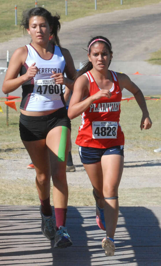 Plainview freshman Breana Figueroa (right) battles Hereford's Mia Castaneda during the District 4-4A girls cross country meet at Mae Simmons Park Thursday afternoon. Photo: Skip Leon/Plainview Herald