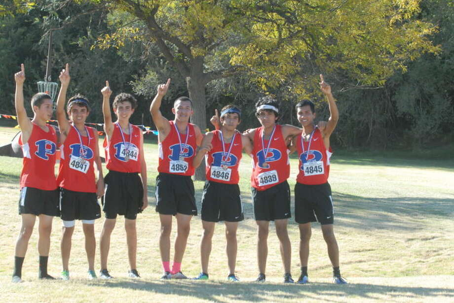 The Plainview boys cross country team gives the No. 1 sign moments after learning they won the District 4-4A championship at Mae Simmons Park in Lubbock Tuesday afternoon. The champs are (from left) Matthew Chavez, Luis Castro, Ricardo Flores, Jarel Rosas, Joey Gonzales, Jordan Castillo and Christian Garcia. Photo: Skip Leon/Plainview Herald