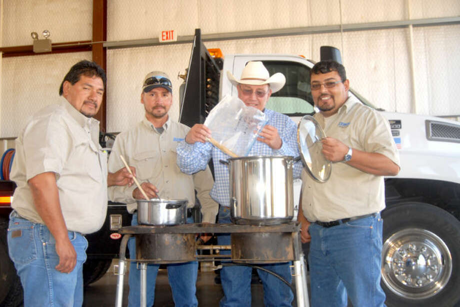Doug McDonough/Plainview HeraldGetting some practice in before the Second Annual Plainview Area United Way Chili Cookoff are four of Atmos Energy's chili experts, Trinidad Zamora (left), Eric Raybal, Jim Tidwell and Rodrigo Benaides. Twelve teams have registered for the event, which will be held at the Atmos Service Center at 200 S. I-27. The cooking begins at noon with judging about 5:30 p.m. It opens to the public at 5 p.m., with all-you-can-eat chili for $5 per person. All proceeds go to the United Way. Sixty door prizes will be given away and plaques will be awarded to the top three teams in two divisions. Atmos will have two teams competing — Top Secret and the Mangy BEAF Cattle Company.