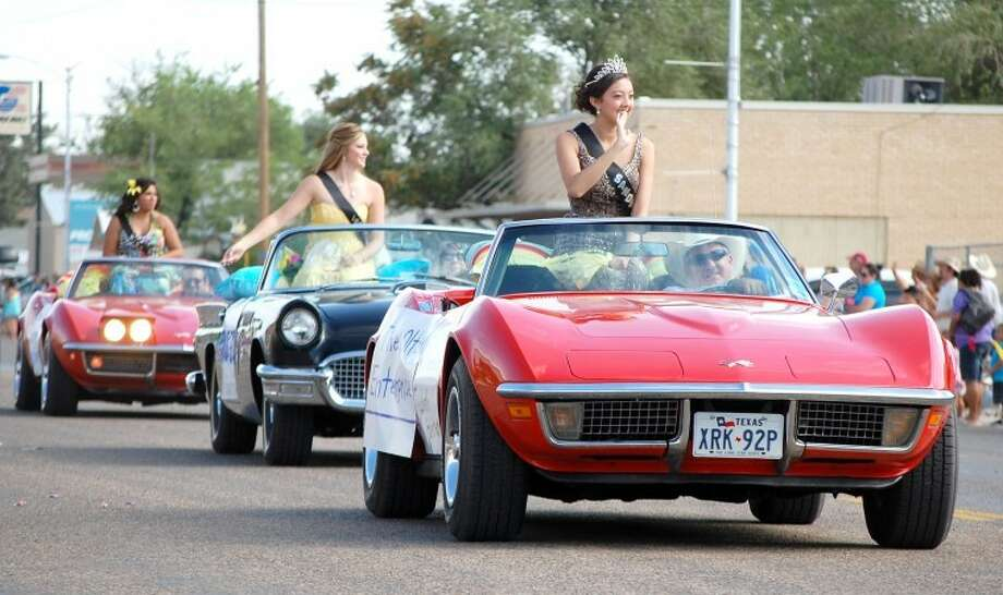 Three of the top finalists in the Sandhills Sweetheart Pageant - winner Jenabeth Gunter (front), first runner-up Brooke Goen and Jenna Diaz - are conveyed through downtown Olton in a pair of Chevrolet Corvettes and a Ford Thunderbird during the Sandhills Celebration on Saturday. The parade was one of the highlights of the 32nd annual celebration which spanned four days. (See more photos from the festivities on Page 6B and online at www.MyPlainview.com.)