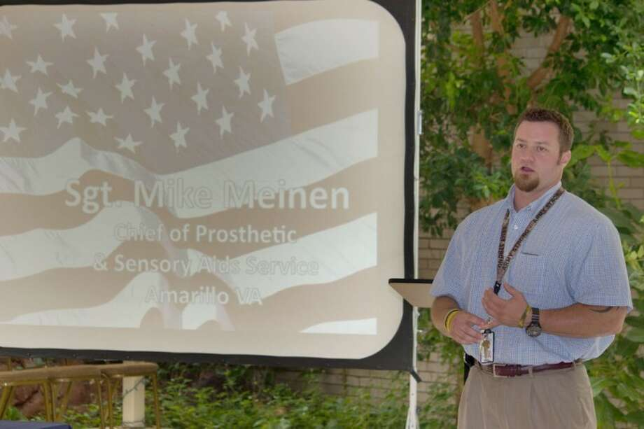 Sgt. Mike Meinen, whose leg was blown off during an ambush in Iraq, talks about post traumatic stress disorder Thursday at an event sponsored by Area Health Education Center of the Plains.