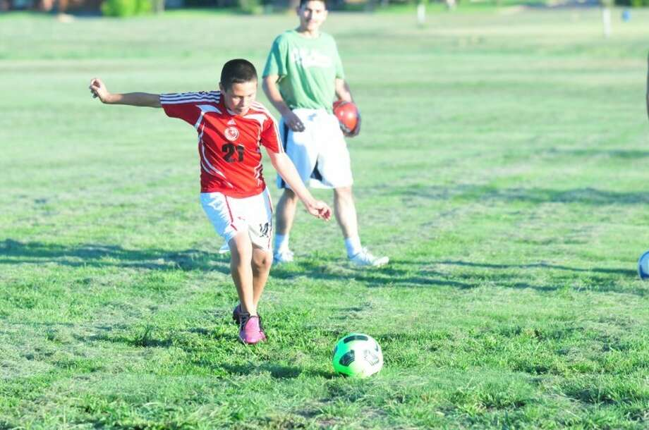 Plainview's Atlas soccer player Carlos Rivera takes a shot at goal at a recent practice. Photo: Homer Marquez/Plainview Herald