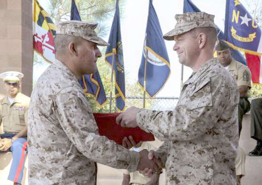 Cpl. Emmanuel Ramos/(U.S. Marine CorpsLieutenant Col. John O'Neal (left), commanding officer, 15th Marine Expeditionary Unit presents Staff Sgt. Mario Rodriguez, warehouse chief, with various letters of appreciation and his certificate of retirement during his retirement ceremony on Oct. 25 at Camp Pendleton, Calif. Rodriguez, 39, served 20 years and is a native of Plainview. The letters of appreciation were from President Barack Obama, Gen. James F. Amos, commandant of the Marine Corps, and Sgt. Maj. Micheal P. Barrett, sergeant major of the Marine Corps.