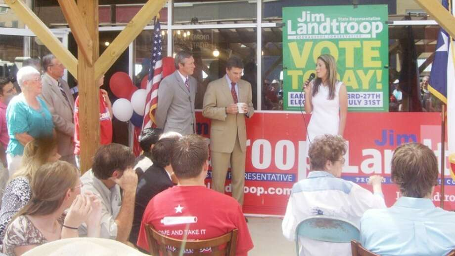 Cathy Landtroop speaks just before her husband Jim addresses a crowd of supporters outside The Broadway Brew in downtown Plainview. Gov. Rick Perry, enjoying a cup of Bravo Brew latte, would speak next and encourage people to participate in early voting. Photo: Shanna Sissom   Plainview Herald