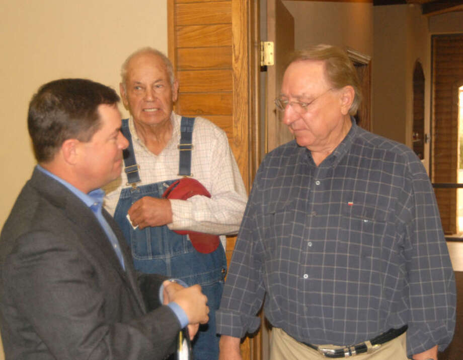 Doug McDonough/Plainview HeraldFollowing a cordial handshake following a town hall presentation on Wednesday, Texas House District 88 Rep. Ken King (left) and former Texas House Speaker Pete Laney, from Hale Center, visit while Hart resident Harold Smith looks on.