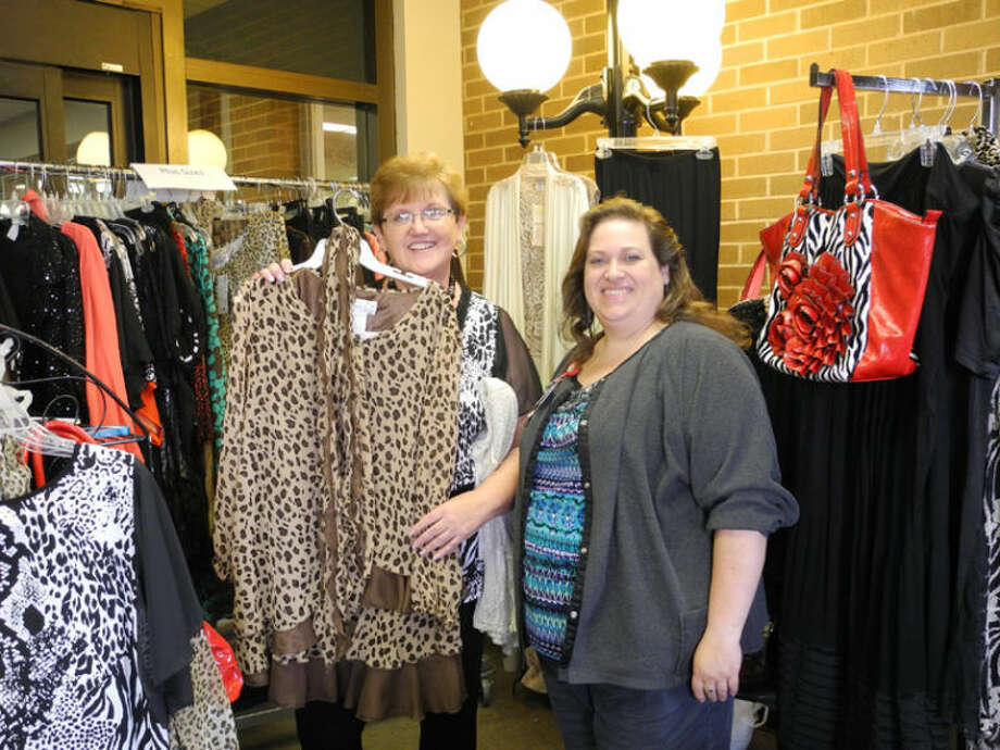 Sherri Neff and Traci Lawrence display items of clothing at a crafts sale held at Covenant Hospital Plainview Wednesday. Photo: Gail M. Williams | Plainview Herald