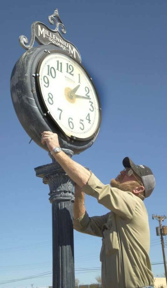 "Jason Johnson/Plainview HeraldGetting a jump on this weekend's time change, City of Plainview Parks Department crew leader Jerry Haney sets the clock at Millennium Square back an hour. Daylight saving time officially ends at 2 a.m. Sunday as most Americans ""fall back"" one hour."