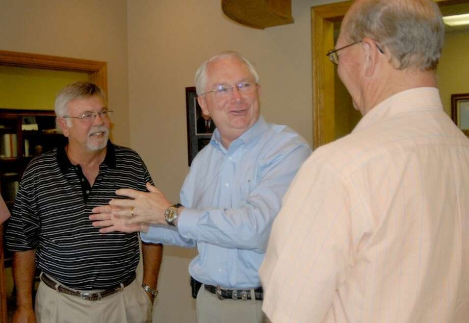 U.S. Rep. Randy Neugebauer (above center) is flanked by Jim Mock (left) and Mike Fox as they visit prior to Thursday's luncheon, hosted by the Plainview/Hale County Industrial Foundation. Neugebauer (R-Lubbock) spent a few minutes talking about recent work in Washington, including the debt ceiling debate and vote, and then took questions from local business leaders. Photo: Richard Porter/Plainview Herald