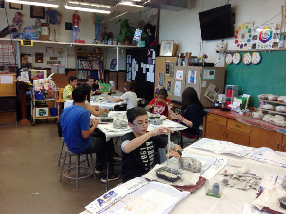 "Students at Estacado Junior High, grades 6-8, created works of art for ""The Rains Came Down: Noah & the Ark"" showing at Abraham Art Gallery through Dec. 10. Here they work with wire-line sculpture. Photo: Kathy Tanner 