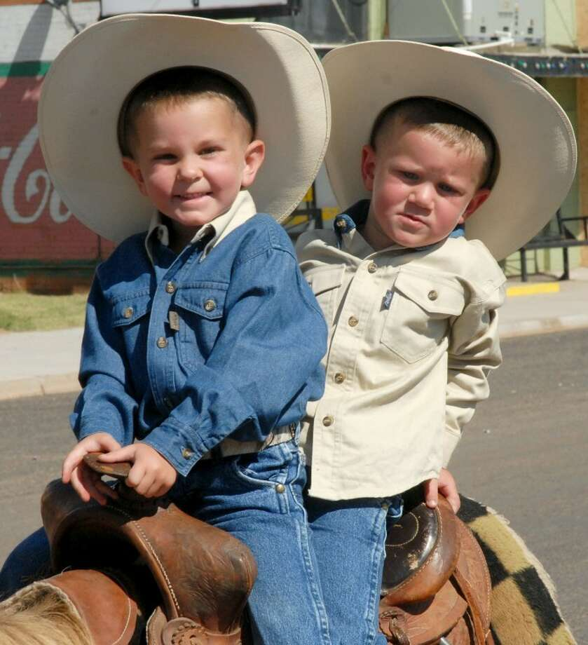 Four-year-old Brenham Crouch (left) and his  3-year-old brother, Brekton, ride through the Petersburg Day parade in this 2010 file photo. They are the sons of Leighton and April Crouch of Lubbock. Photo: Plainview Daily Herald