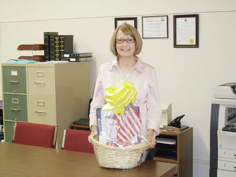 Linda Shipp with a sample of a basket planned for returning soldiers. Photo: By Gail M. Williams | Plainview Herald