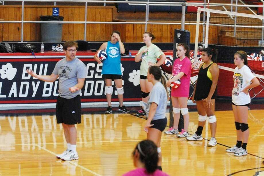 At a recent camp at the Doghouse, head West Texas A&M volleyball coach Jason Scoach (left) teaches campers proper footwork in several passing and defensive drills. Photo: Homer Marquez/Plainview Herald