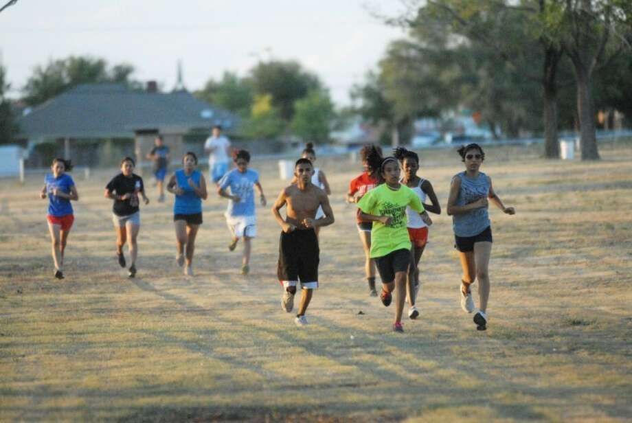 Above Plainview's cross-country gets the season rolling with the start of two-a-day workouts at the Running Water Draw. Photo: Homer Marquez/ Plainview Herald