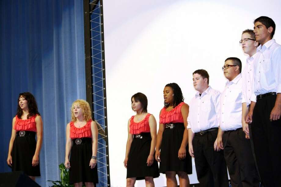 The Plainview High School Chamber Singers, under the direction of Walter Wright, provided musical selections during the school district's 2011 convocation. Shown are Kaitlin Hukill (left), Amanda Painter, Desiree Villarreal, Divetrea Whitaker, Robbie Riley, Aaron Alcozer, Coulter Teel and Pete Castillo. Photo: Jan Seago Plainview ISD