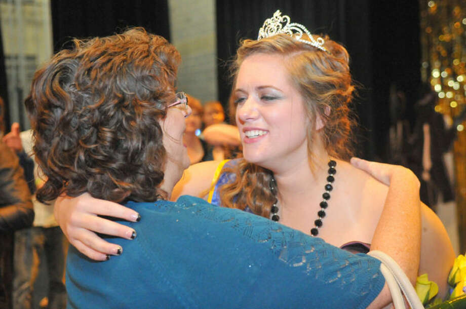 Wayland Baptist University PhotoNicole Adams gets a congratulatory hug from her mother Tinia Adams after being crowned Miss Wayland 2014 on Saturday night.