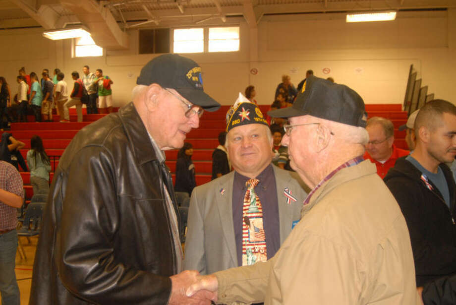 Doug McDonough/Plainview HeraldLocal military veterans John McDonough (left), Ralph Langley and Norman Wright visit following the 11th annual Veterans Day program at Estacado Junior High School. Wright participated in the most recent South Plains Honor Flight to Washington, D.C.